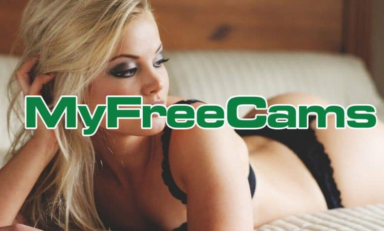 blonde cam girl on bed with myfreecams logo hovering over