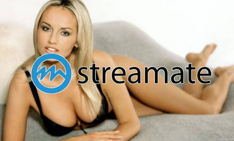 sexy blonde cam girl posing on bed with streamate logo overlay